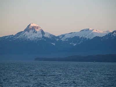 Sunset touching the top of the mountains in Lynn Canal, near Shelter Island (2006).