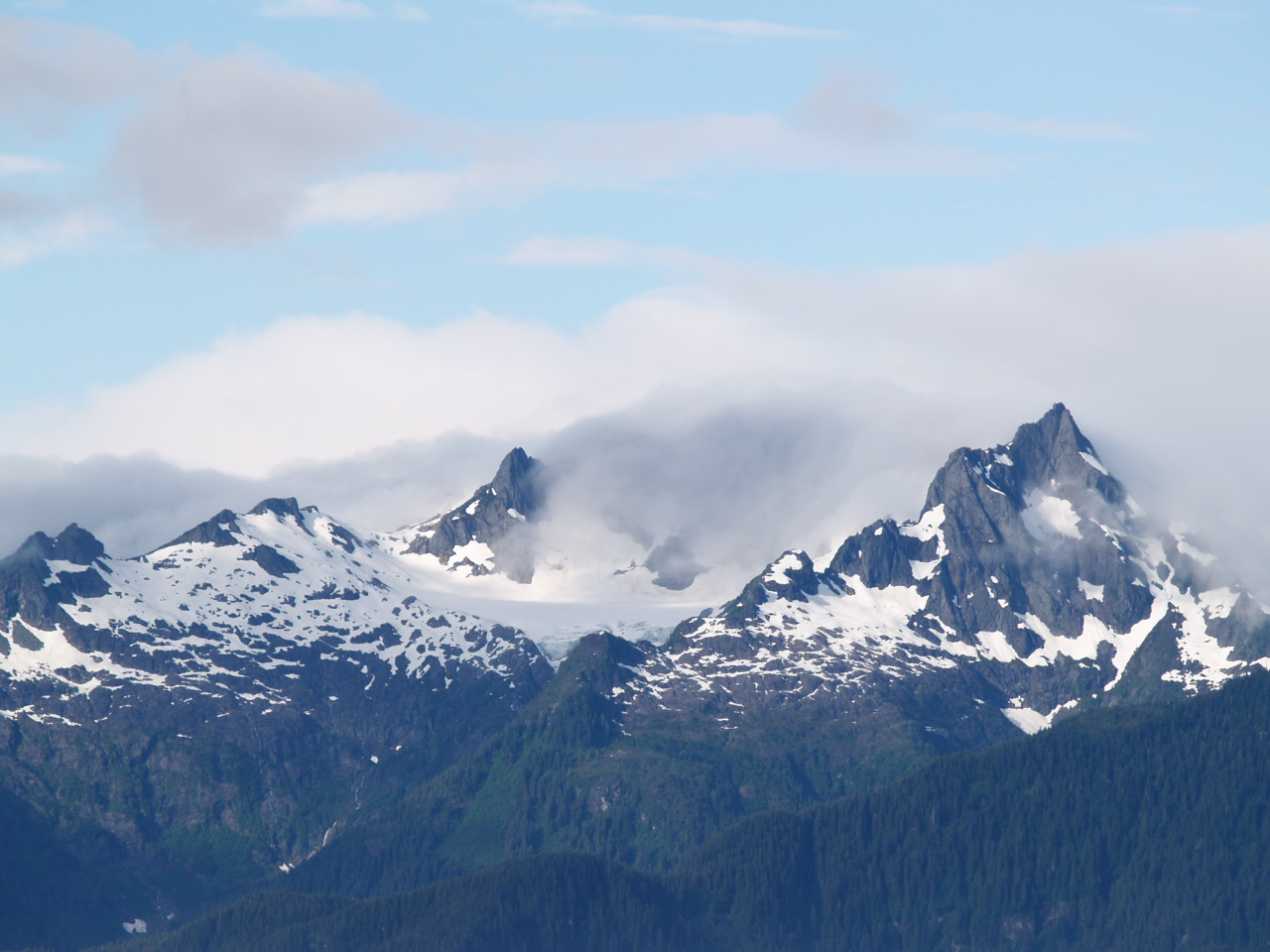 At times, the clouds would clear and reveal these sharp, jagged peaks - Catham Strait (2006)