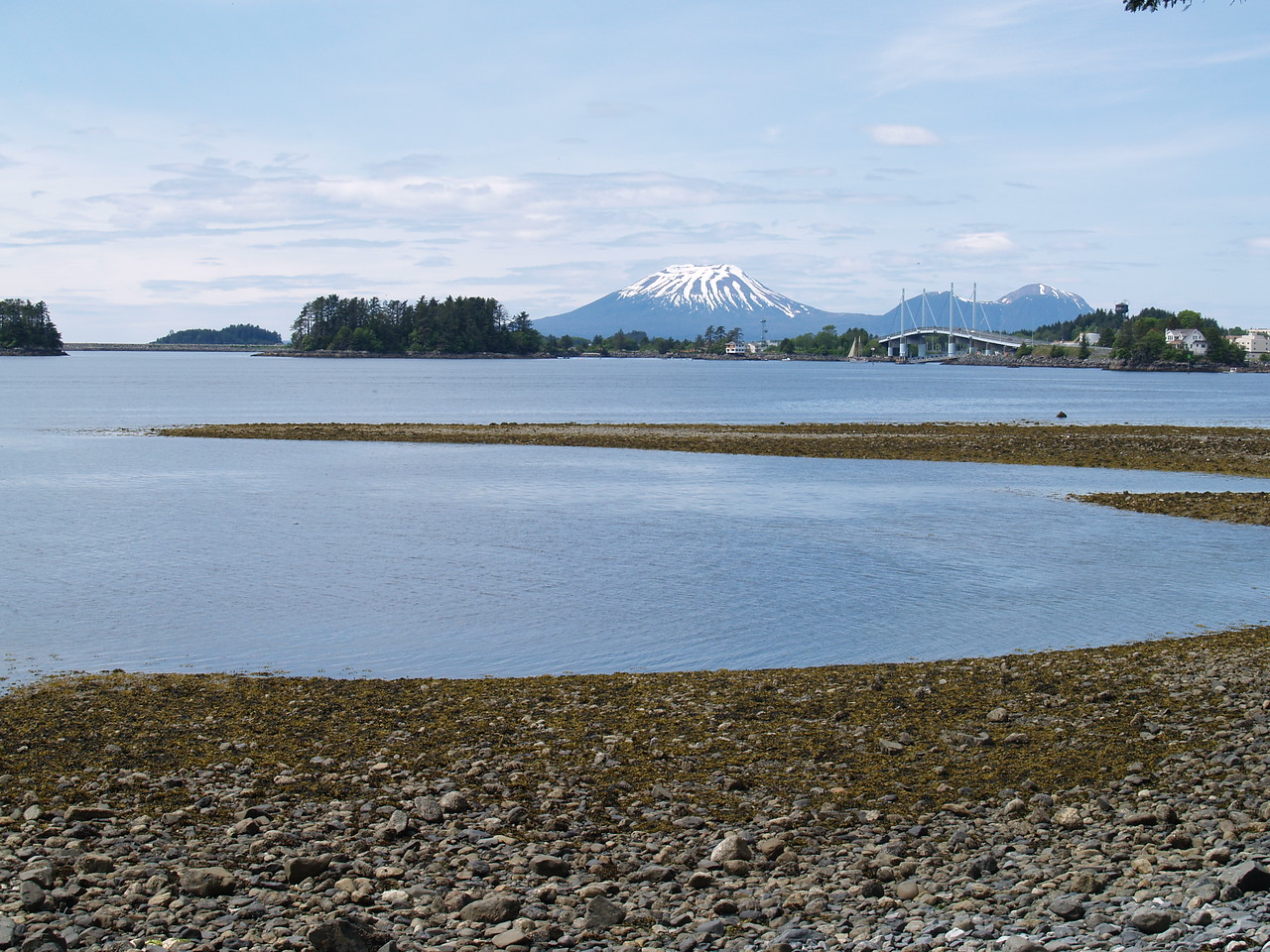 """I lived and worked in Sitka during the summer of 2007. It is experience that I will never forget. I would do it again. Here was my """"office view"""" every day. Mt. Edgecumbe is an extinct volcano and good thing - it's only 14 miles from Sitka. It's on Kruzof Island and accessible by boat. There are a lot of bears on the island but some awesome hiking trails, too!"""