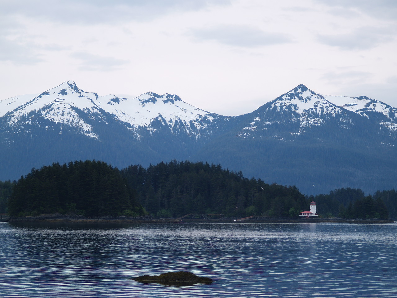 Pyramid Mountain is on the right, above the lighthouse. This is not an official Coast Guard lighthouse. It was constructed by a veteran's group and you can rent it out. You take all your provisions with you and you will need a skiff to get back and forth to Sitka. (May 2007)