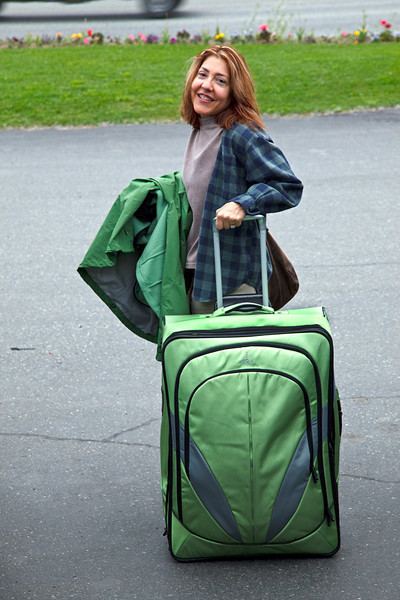 """We met up with our friend, Lisa, in Anchorage.  This is her definition of packing """"light.""""  This suitcase is almost half her height."""