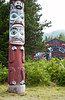 A totem pole and longhouse at the Saxman Native Village in Ketchikan, Alaska, USA, America.
