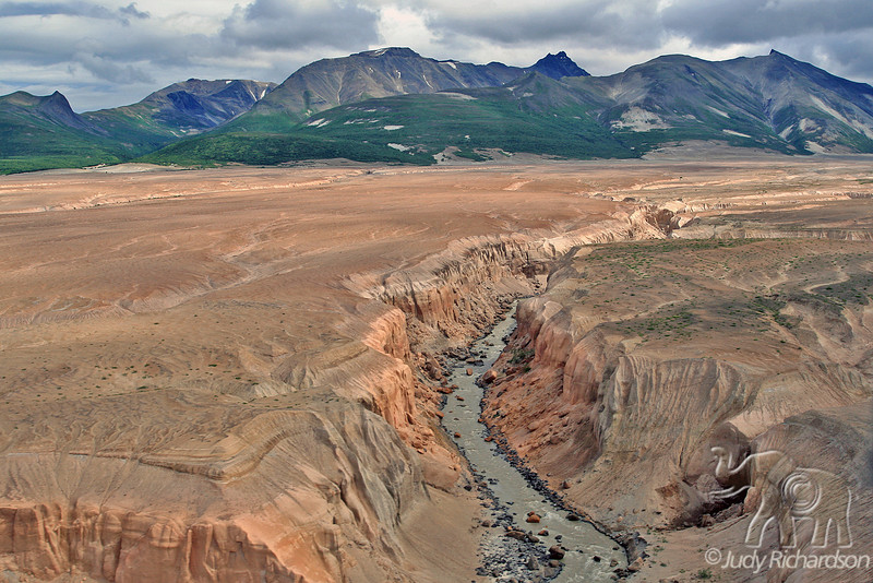 Mountains and deep canyon formed by glacial runoff