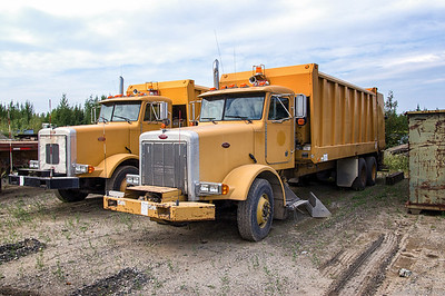 Pair of Peterbilt Heil Formula 5000 31yd Rear Loaders
