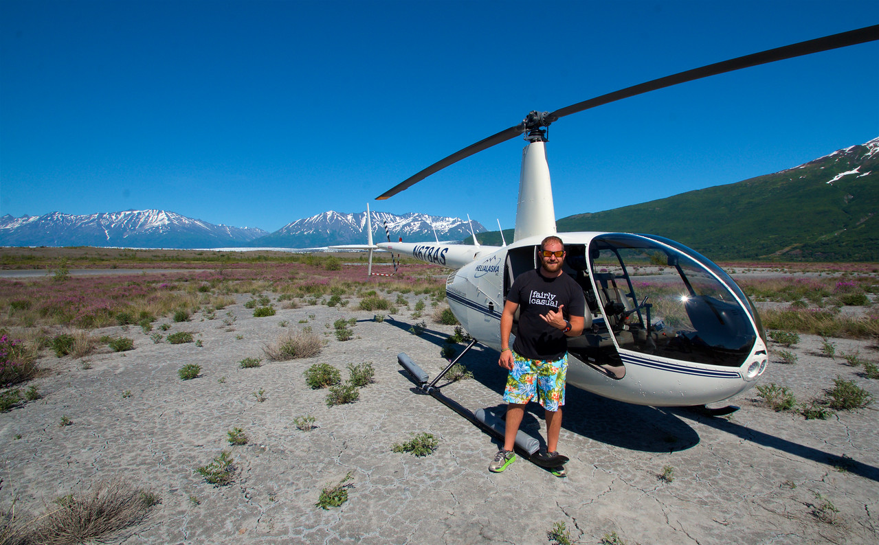 A picture of me by using a timed exposure in front of the helicopter and the mountains of Alaska.