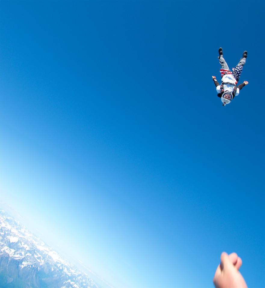 Matt Jaskol, flies head down in colorful American shorts above the Glacier.