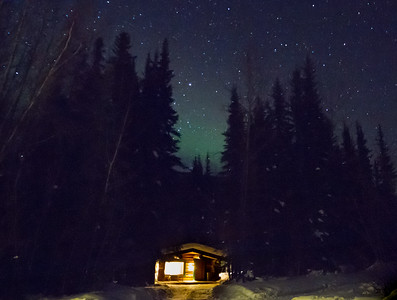 Cabin in the Woods with Northern Lights in Fairbanks, Alaska