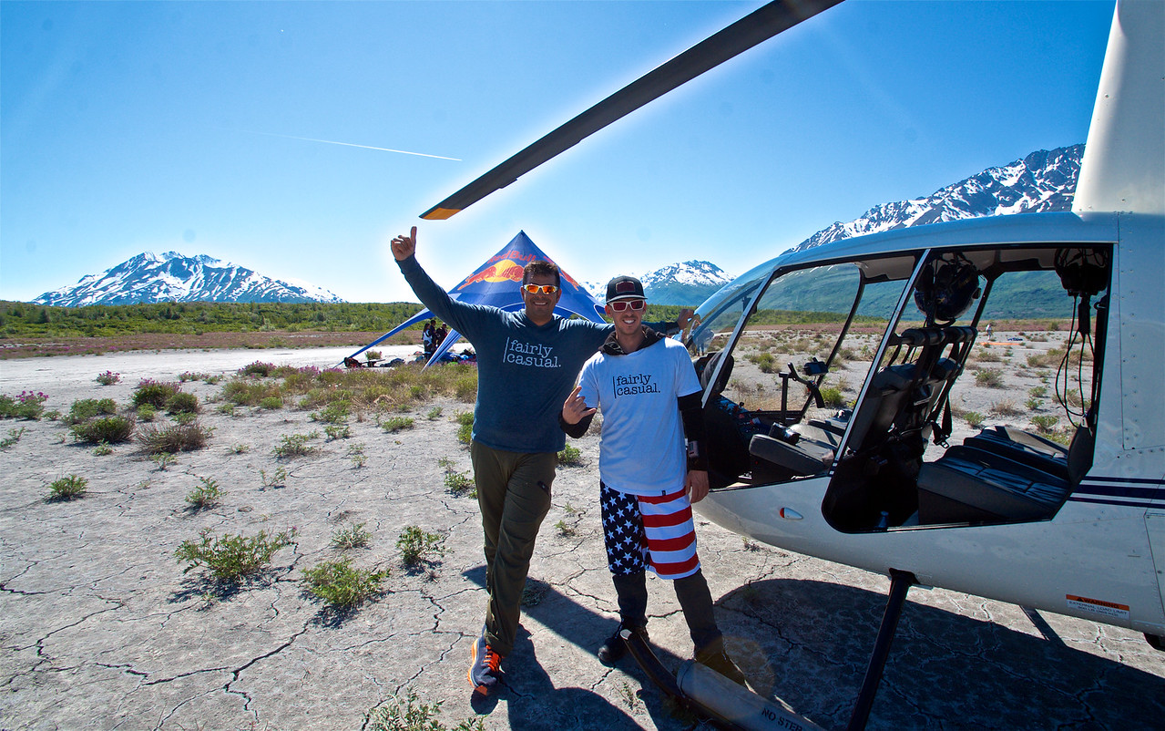 Stephen Hatz and Matt Jaskol pose after a skydive onto the Glacier,  in front of the Mountains and the Red Bull Tent during the summer solstice event in Palmer Alaska. Picture by Curt Vogelsang.