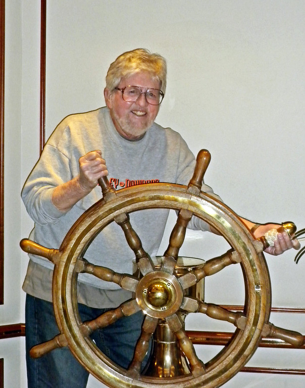 Frank steering the boat. Watch out for the rocks. Abandon ship!