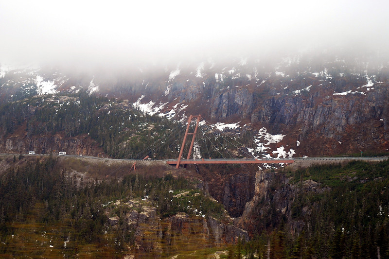 Bridge anchored on one side only, to allow for the movement from earthquakes (very common in Alaska)