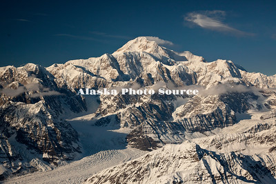 Alaska. In this aerial view, clouds are blowing off the northeast peak of Mt. McKinley with the Kahiltna Glacier in the foreground, Denali National Park.