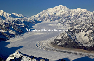 Alaska. In this aerial view, fresh snow whitens the mighty Kahiltna Glacier leading the way up to Mt. McKinley, Denali Natl. Park.