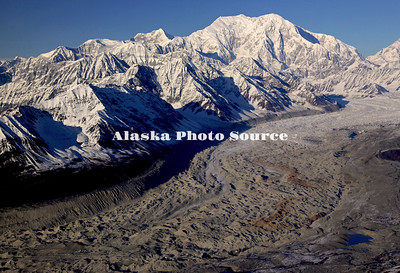 Alaska. In this aerial view, the Lacuna Glacier leads the way up to Mt. Foraker, Denali Natl. Park.