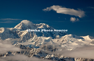 Alaska. In this aerial view, clouds are blowing off the northeast side of Mt. McKinley with a lenticular cloud in the foreground, Denali National Park.