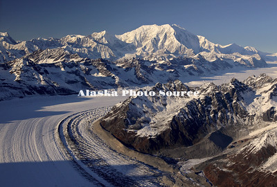 Alaska. In this aerial view, the Kahiltna Glacier leads the way up to Mt. Foraker, Denali Natl. Park.