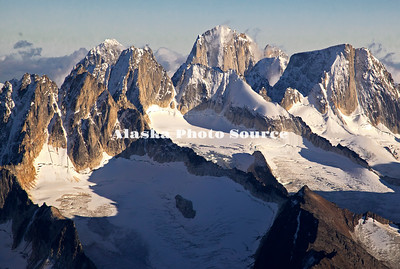 Alaska. In this aerial view, evening light highlights the Cathedral Spires and glaciers in the Kichatna Mountains,  Denali National Park & Preserve.  The granite Cathedral Spires are the highest strand of vertical rock in North America.