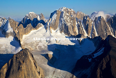 Alaska. In this aerial view, evening light highlights the Cathedral Spires and related glaciers in the Kichatna Mountains, Denali National Park & Preserve.  The granite Cathedral Spires are the highest strand of vertical rock in North America.