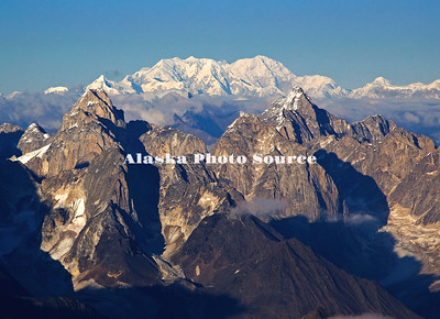 Alaska. Aerial view of Cathedral Spires, Kichatna Mountains, with Mt. Foraker and Mt. McKinley in the background,Denali National Park & Preserve. The granite Cathedral Spires are the highest strand of vertical rock in North American.