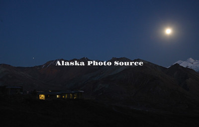 Alaska. Eielson Visitor Center after dark in Denali Natl. Park, with Jupiter rising overhead and the moon glowing.