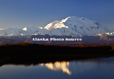 Alaska. Warm, morning light basks Mt. McKinley while mirrored in Reflection Pond, Denali National Park & Preserve.
