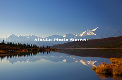 Alaska. In this view of Wonder Lake, the autumn tundra adds a colorful foreground to Mt. McKinley basked in morning light, Denali National Park.
