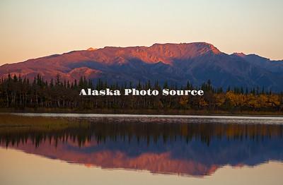 Alaska. Autumn mountain reflection in Otto Lake, Healy.