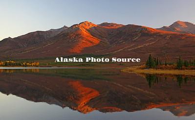 Alaska. Autumn mountain reflection in Otto Lake at Sunset, Healy.