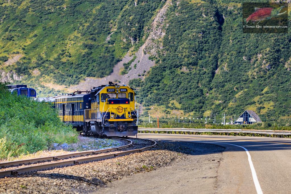 Alaska Railroad Passenger train and the Anton Anderson Memorial Tunnel in the background