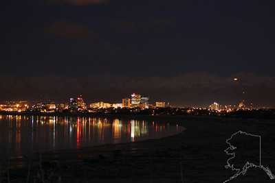 Anchorage on a winter night. The star you see is lit at Thanksgiving and is turned off when the last musher comes in to Nome in the Iditarod Dog Race. This view of Anchorage is from Earthquake Park.