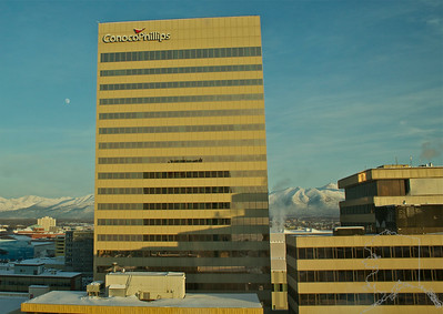 One of the Big oil companies in Anchorage. To the left of the building you can see the moon.