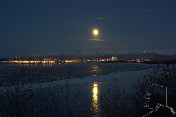 Anchorage on a winter night with a full moon.