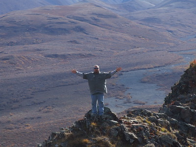 Me deep into Denali National Park on top of a mountain.