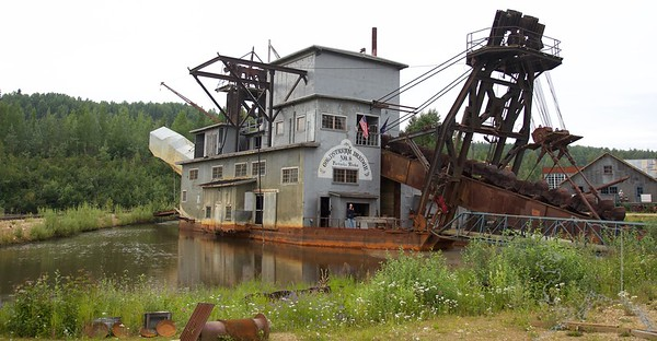Described as either a floating workhorse or a mechanical gold pan, Gold Dredge 8 extracted millions of ounces of gold from the frozen Alaskan ground. Today, Gold Dredge 8 National Historic District serves as a monument to the hard working miners who built Fairbanks. Gold Dredge 8 is also a National Engineering Landmark.  Gold Dredge 8 operated between 1928 and 1959 and played an essential role in mining and the economy of the Tanana Valley. It is said that dredges and mining saved Fairbanks. In 1942, gold mining suffered a serious setback; the War Productions Board issued it's famous Order L-208 which forced the closure of all gold mines in the United States for the duration of World War II. After the war was over, very few mines re-opened. By the time the war ended, the miners that once ran the gold mines were in other professions and their wage levels had increased too high for gold mining to support. But Gold Dredge 8 was one of the few mines that did re-open and ran successfully until it was shut down for economic reasons in 1959.  In 1984, the dredge was opened for tours. The Binkley family has run a successful sternwheel attraction for over 60 years and added gold mine tours in 1994.  They have been working to share our rich gold mining history with visitors ever since.