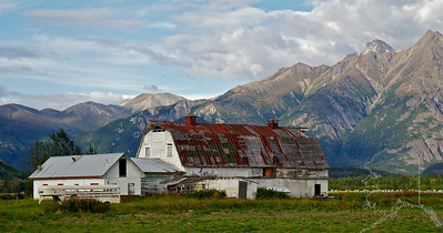 Nice old barn out in the Butte. I did not take this shot I was driving, So my wife Donnette took it. Great job Angel....