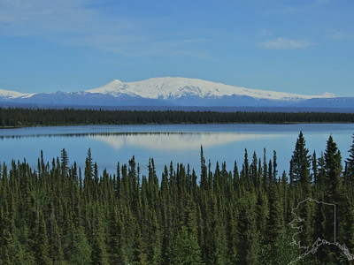 Wrangell St. Elias. Mount Wrangell itself, a massive shield-shaped volcano and namesake of the range, still signals its active presence with steam plumes, while nearby, Mounts Sanford, Drum, and Blackburn lie dormant.