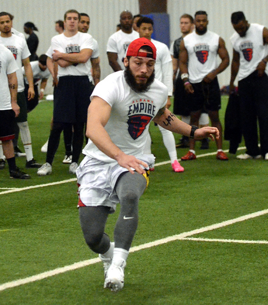 . STAN HUDY/SHUDY@DIGITALFIRSTMEDIA.COMAlbany Empire tryout Eugene Padula races toward an end line during the shuttle run Saturday during the nationwide open tryouts at the SportsPlex of Halfmoon.