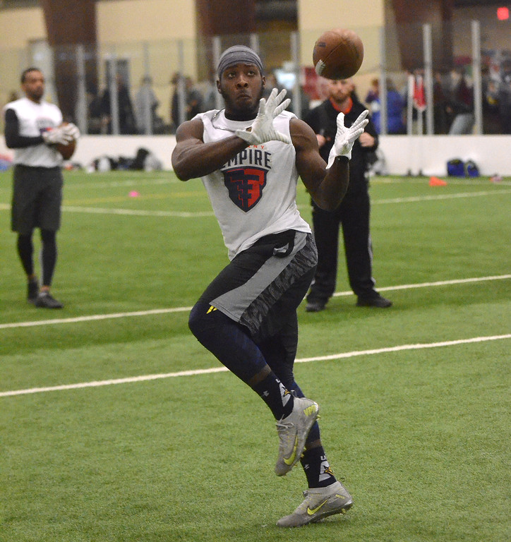 . STAN HUDY/SHUDY@DIGITALFIRSTMEDIA.COMAn Albany Empire tryout looks to catch a pass during receivers drills Saturday during the nationwide open tryouts at the SportsPlex of Halfmoon.