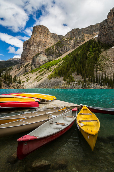 Colorful canoes for rent at Moraine Lake in Banff National Park, Alberta, Canada.