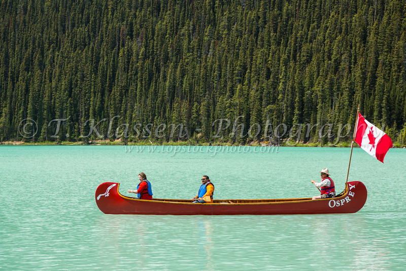 A canoe with Canadian flag on Lake Louise, Banff National Park, Alberta, Canada.