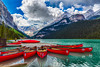 The Victoria Glacier and red canoes at Lake Louise, Banff National Park, Alberta, Canada.