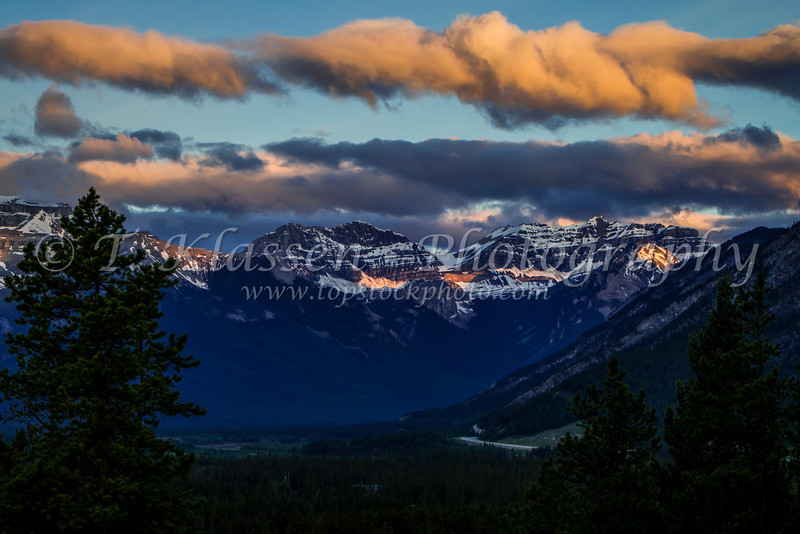 Sunrise illuminating snow capped peaks in the mountains of Banff National Park, Alberta, Canada.