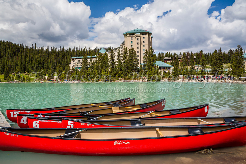 Red canoes and the Fairmont Chateau Lake Louise Hotel at Lake Louise, Banff National Park, Alberta, Canada.