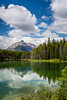 Reflections in Hecter Lake along the Icefields Parkway in Banff National Park, Alberta, Canada.