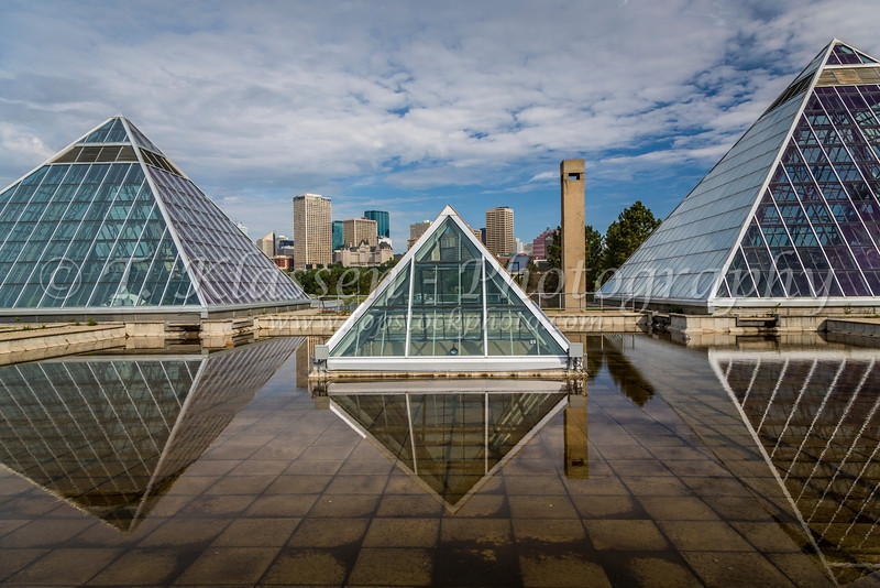 The Muttart Conservatory pyramids and the city skyline of Edmonton, Alberta, Canada.