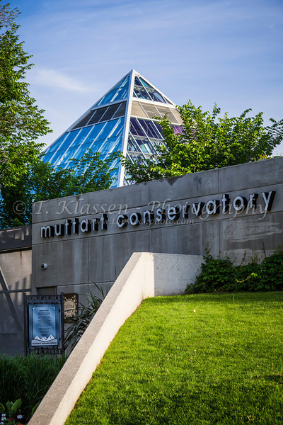 The Muttart Conservatory sign and pyramids in Edmonton, Alberta, Canada.