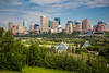 The Muttart Conservatory pyramids and the city skyline of Edmonton, Alberta, Canada.