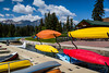 Colorful canoes at the dock at the Fairmont Jasper Park Lodge in Jasper National Park, Alberta, Canada.