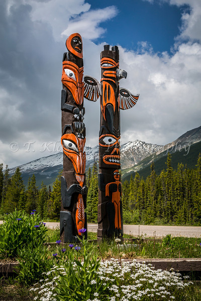 Two totem poles along the Icefields Parkway near Sunwapta Falls, Jasper National Park, Alberta, Canada.