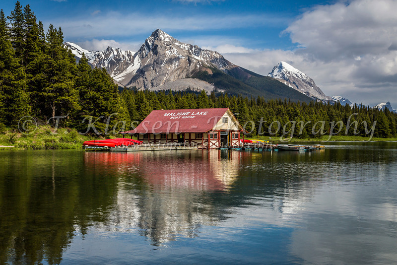 Reflections of the Boat House at Maligne Lake, Jasper National Park, Alberta, Canada.