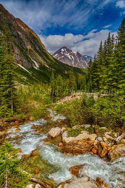 A glacier stream and Pyramid Mountain in Jasper National Park, Alberta, Canada.